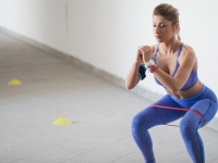 Athlete exercising with rubber band